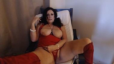 MATURE SMOKING with big natural titties out