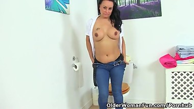 British milf Eva May fingers her fanny on bathroom floor