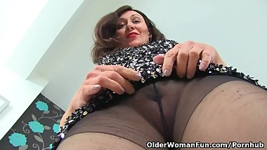British milf Kitty Cream's cunny is lubed up and ready