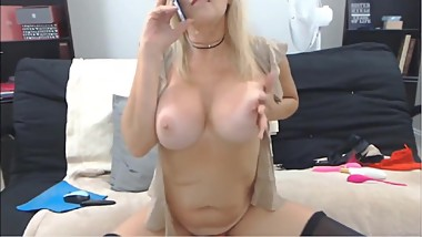 Tender mature blonde mother with big tits talking on the phone