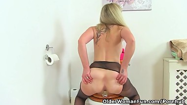 English milf Kat sits on a dildo in the bathroom