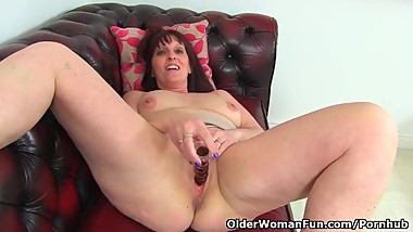 British milf Beau Diamonds dildos her slippery fanny