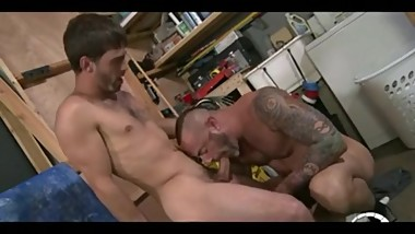 Tattooed muscle daddy rides a big young cock