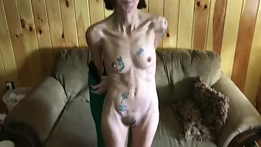 Tatooed mature shows off her scrawny body