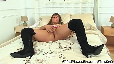 British milf Lelani gets horny in a sexy Santa thong
