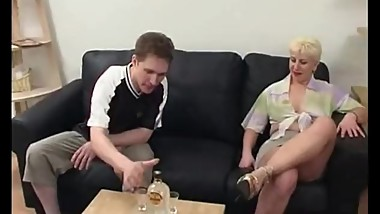Mature blond railed by young cock