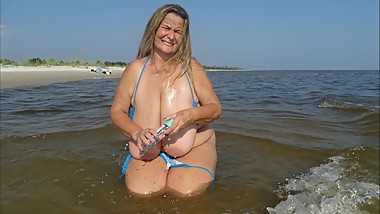 Beach Boob Oil (includes 149 photo musical slide show)