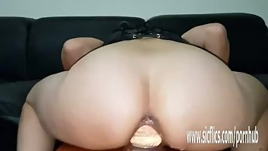 Enormous dildos stretch her greedy pussy