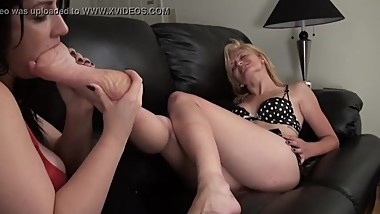 Blonde MILF has her feet worshiped by lesbian brunette