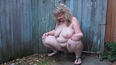 outdoor pissing, full nude mature BBW milf with big tits