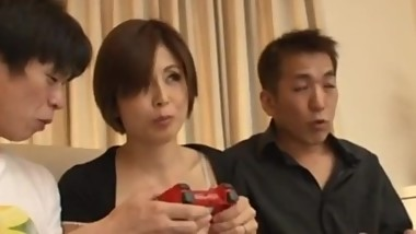 Japanese Mature Milf seduces her son's 2 classmates at home