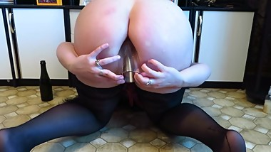 gaping ass, mature busty MILF. Anal with a bottle, a glass in the ass