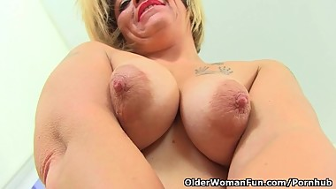 English milf Emma spreads her legs and flicks her bean