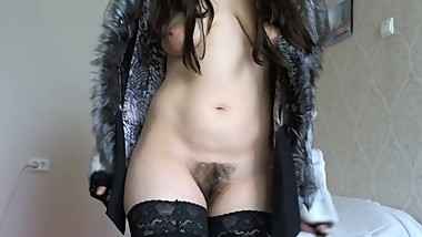 Smokes sexually naked in stockings and in a fur coat