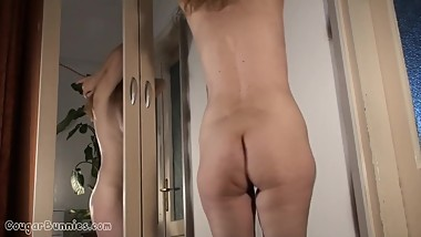 Playful cougar Doris Dawn get naked on cam and shows her hairy bush