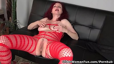 American milf Zinnia Blue looks hot in red fishnet body stocking