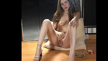 SEXY BRUNETTE SMOKES WHILE MASTURBATING