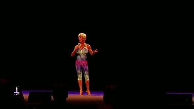 lovely fit septuagenarian woman gives speech at bodybuilding competion