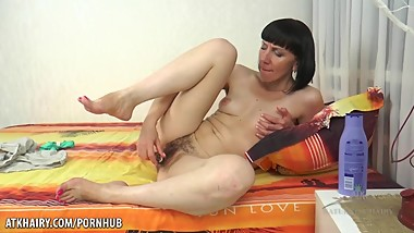 MASH: Mature and super hairy pussy with a toy
