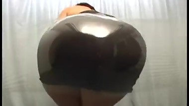 Big Japanese Booty Rubbing Against Transparent Plastic