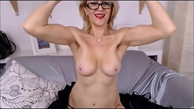 Ugly Russian mature flexes pretty good biceps on cam