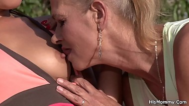 Lesbian brunette toying her old pussy outdoor