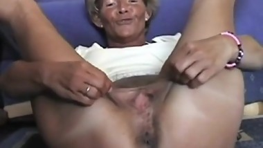 Mature blonde lady spreading her legs.
