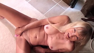 Skinny sexy granny Nancy masturbated with dildo on video