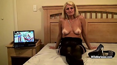 Mature sexy blonde promotes various poses and shows tits