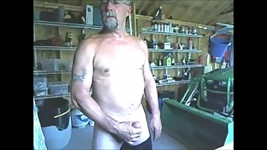 Mature bearded guy unoads his cock in the garage