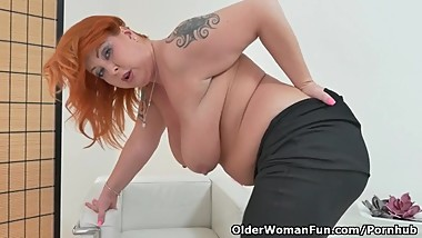 Redheaded milf Alex from Europe strips off and fingers both sex holes