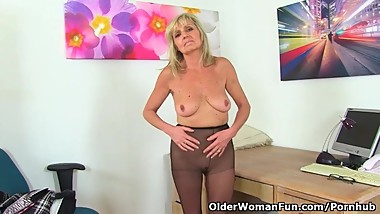 English gilf Dolly puts her dildo to work on her craving cunt