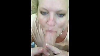Mature feasting on cum outside