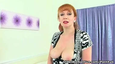 English milf Red fucks her creamy cunt with a dildo