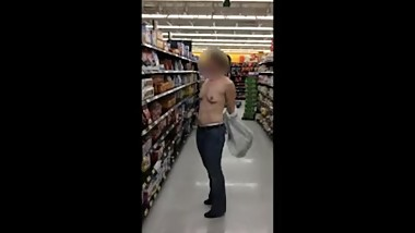 Topless when she turns her jacket inside out while shopping