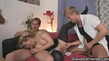 Granny enjoys two cocks in mouth and pussy