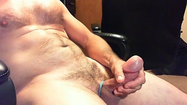 Hairy Daddy plays with fat cock and shoots a big load