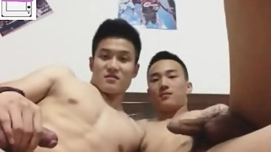 Two young man having handjob in cam