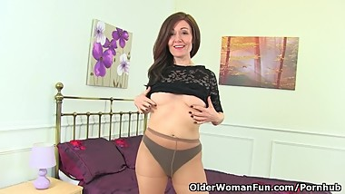 English milf Kitty Cream can't hide her high sex drive
